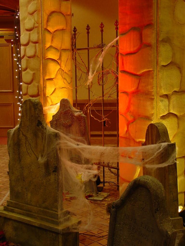 Corporate Halloween Theme 10-2001 (8), graveyard scene spider webs, gate, columns, tombstones